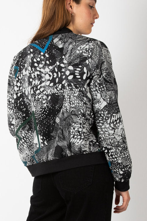 silk bomber jacket in intricate black and white design with blue flashes