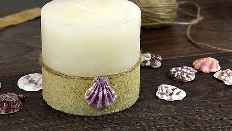 wrap the lower portion of the candle using this craft material and use glue to stick it onto the surface of the candle.