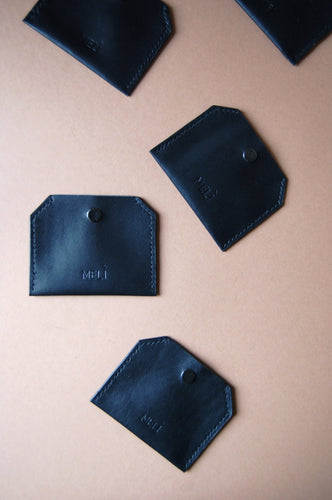 Minimal black leather coin purse handmade by Melì