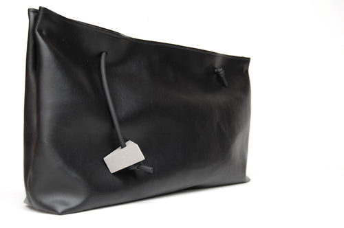 Minimal black pochette faux leather with concrete triangle detail made by Melì