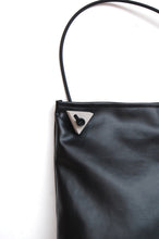 Minimal hobo bag with concrete triangle detail made by Melì