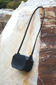 Minimal leather crossbody bag handcrafted by Melì in Berlin