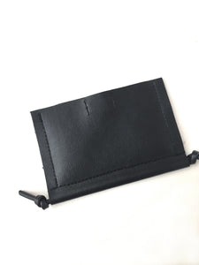 Minimal black cardholder wallet made by Melì