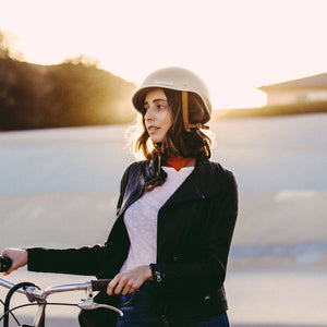 Thousand helmet gold girl with bike sunset
