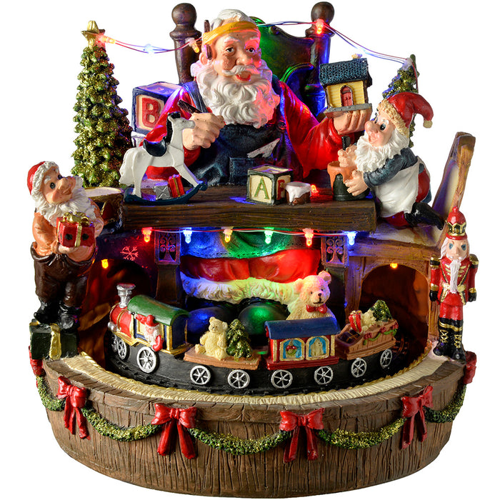 Pre Lit Rotating Christmas Tree.Pre Lit Led Musical Animated Santa S Workshop Scene With Rotating Train 25 Cm