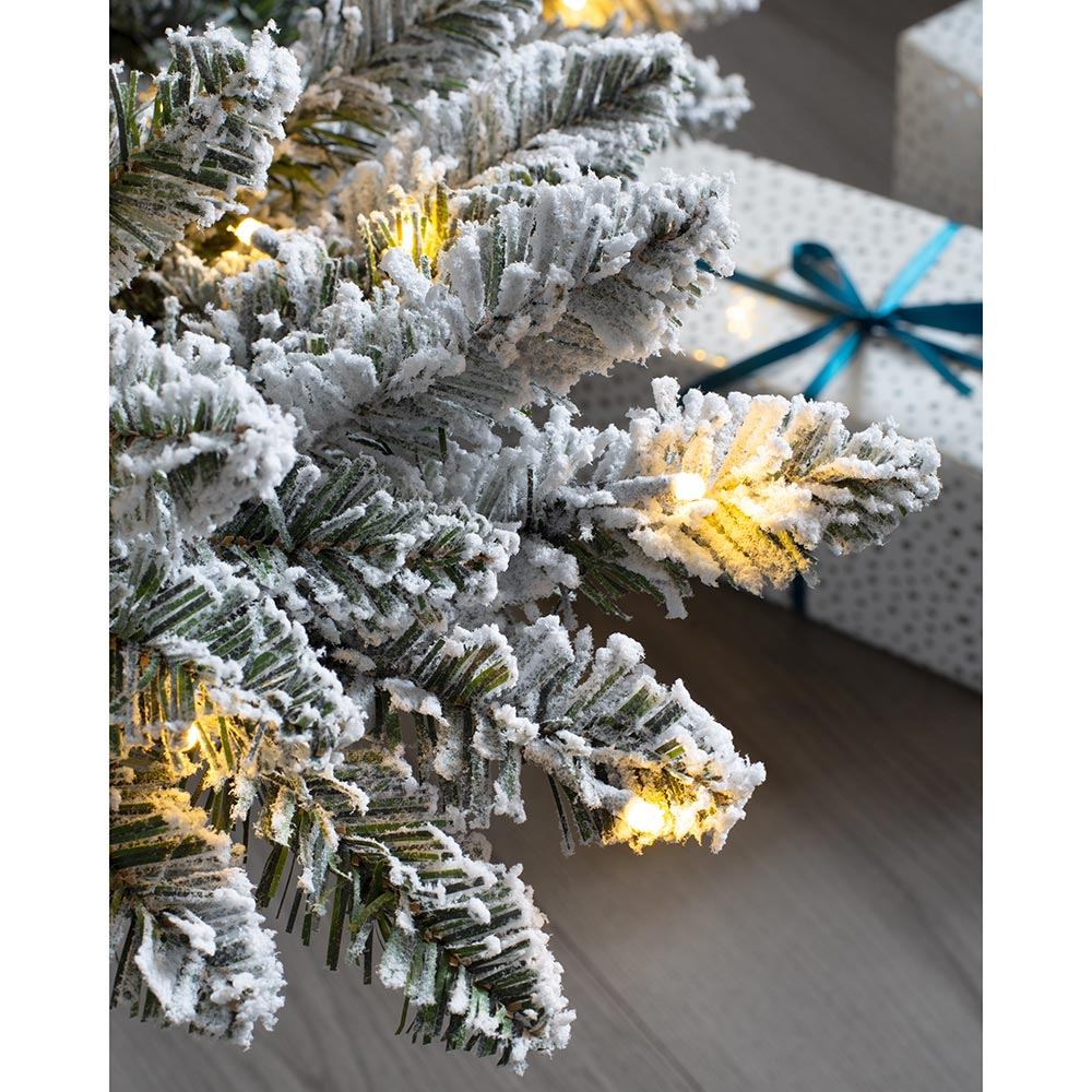 Pre-Lit Full Bodied Snow Flocked Christmas Tree with Chasing Warm LED Lights