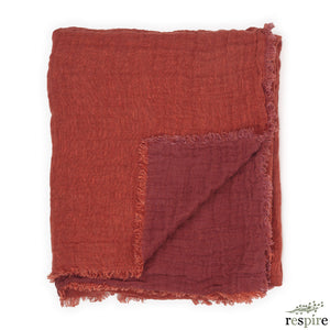 Washed waffled linen blanket in brick colour