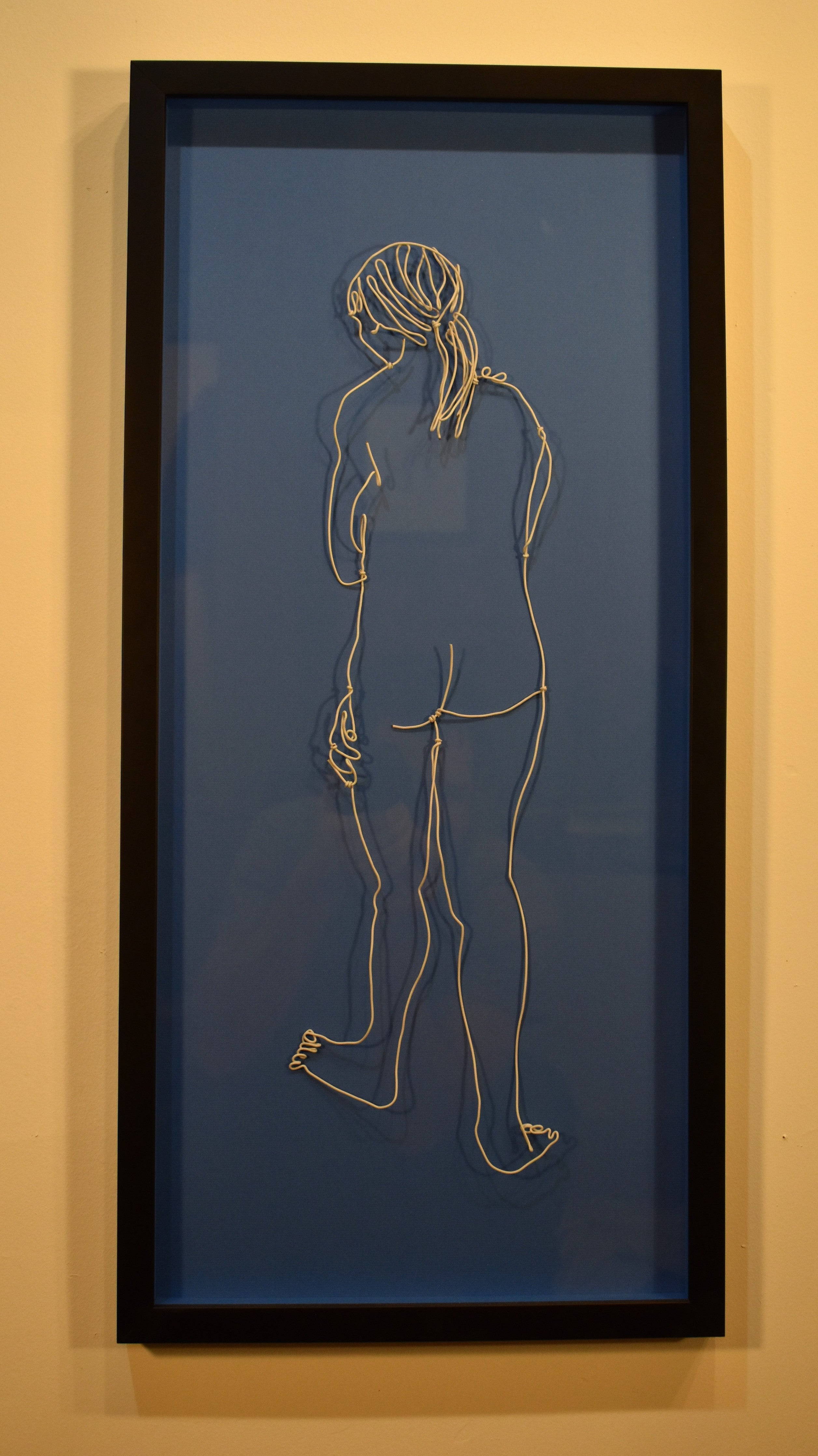 White Wire Figure on Blue