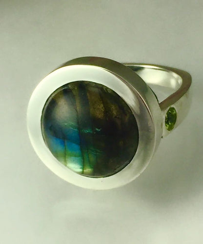 Heavy bezel sterling silver and round labradorite ring