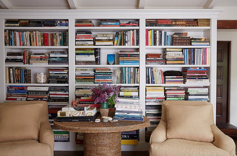 Massive bookshelf, two armchairs and a coffee table