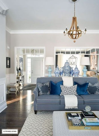 Blue couch and pillows in a cream tone living room