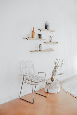 white chair and wall shelves