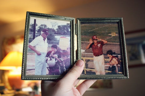 picture frame of elderly man with a young boy in sports attire