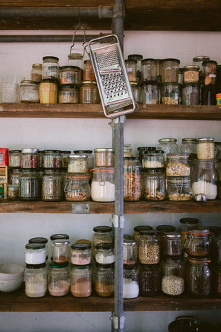 shelves with spices and ingredients in jars