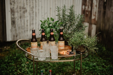 bar cart with bottles and glasses