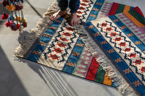 colorful bohemian area rug with fringed edges