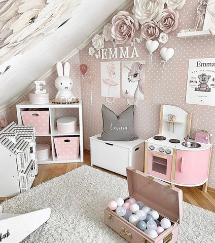 Gray and pink toys and room accessories in a girl nursery