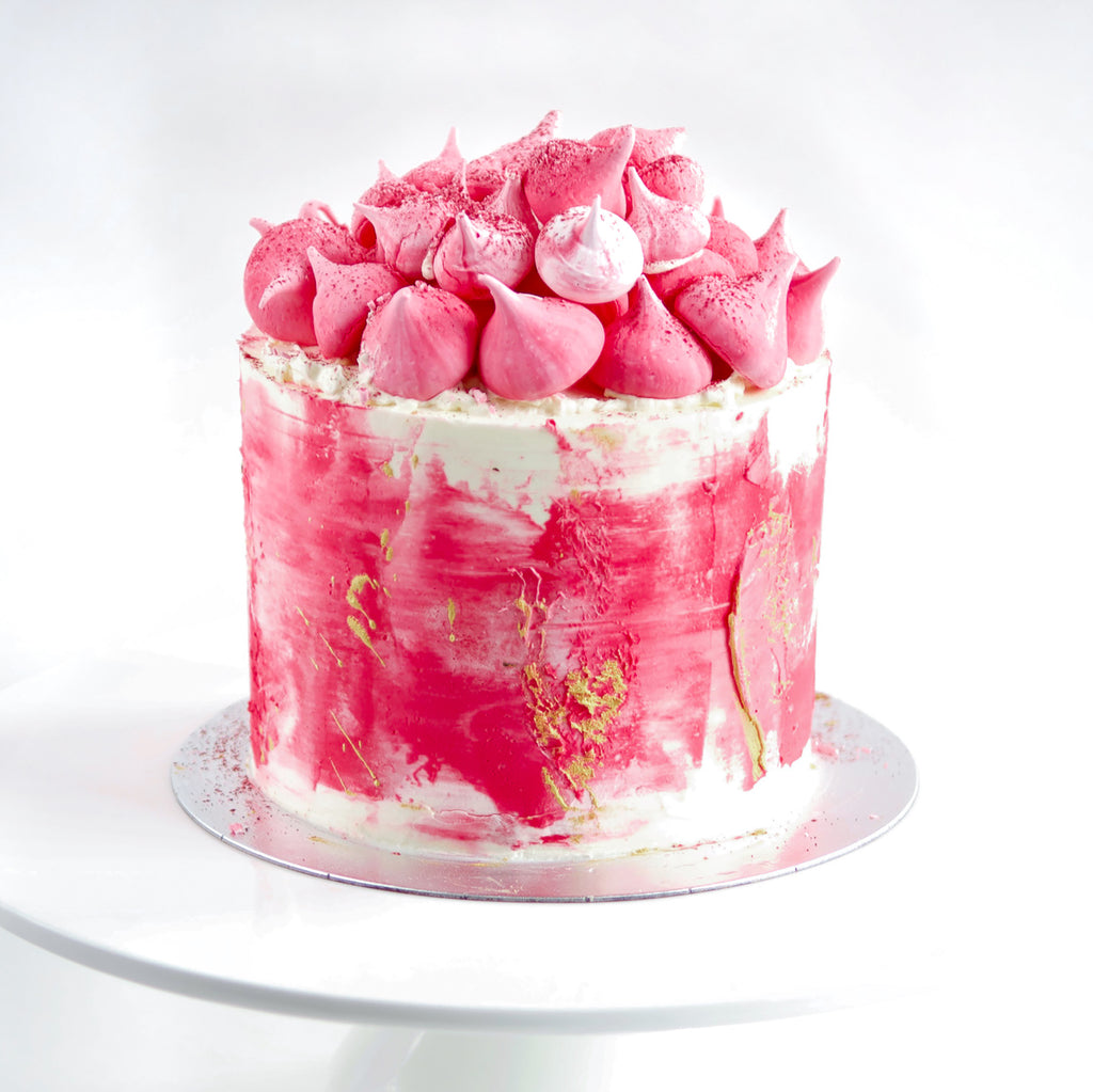 lemon, raspberries and cream layer cake with pink meringue  decoration. London delivery available