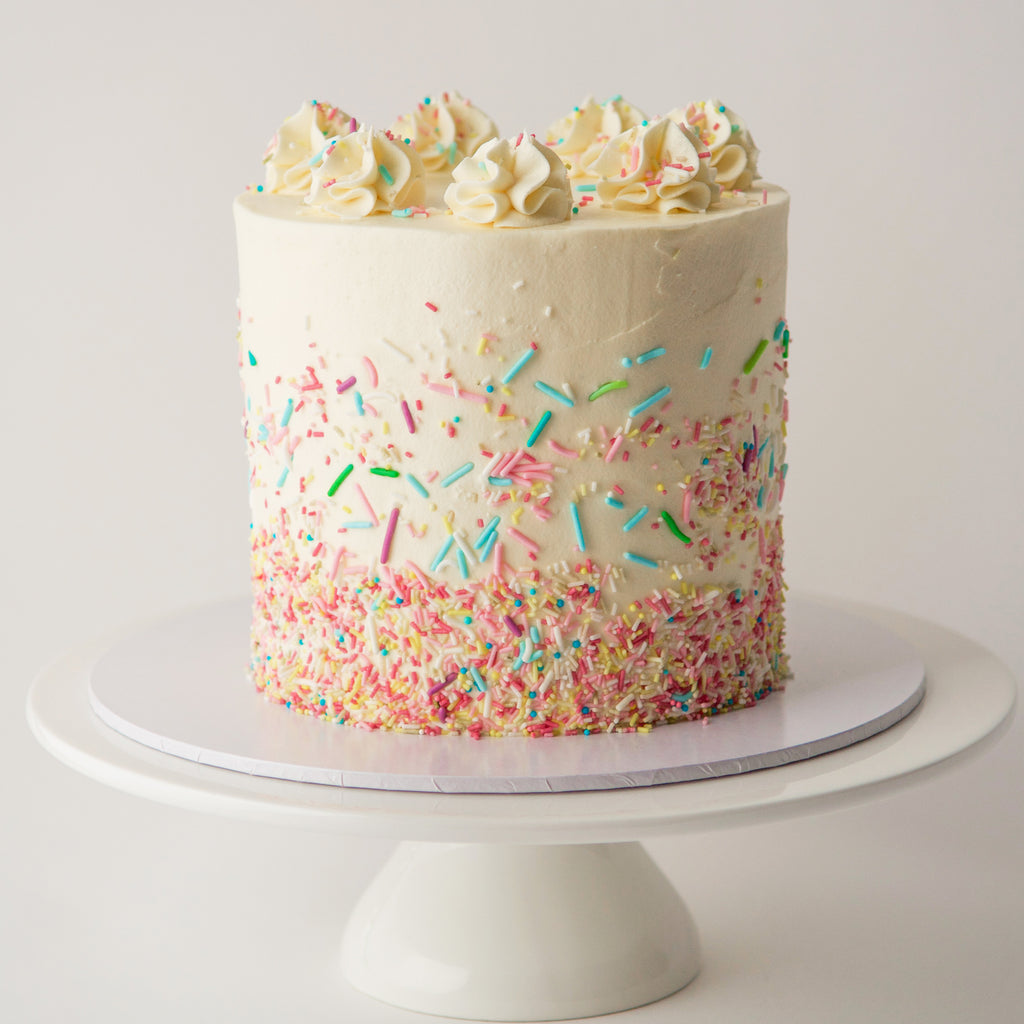 Vanilla sponge cake with sprinkles. Swiss meringue buttercream and jam. London delivery