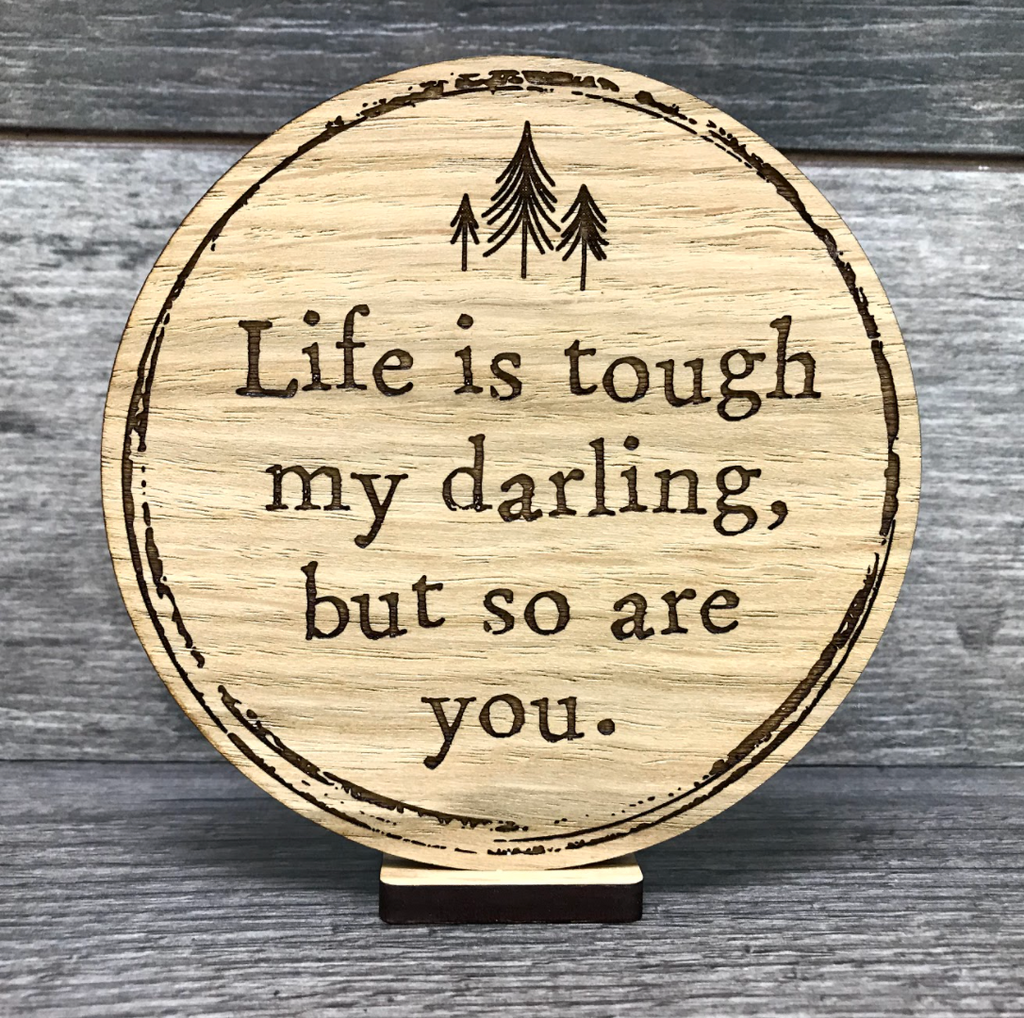 Engraved oak wooden disc saying Life is tough my darling, but so are you.