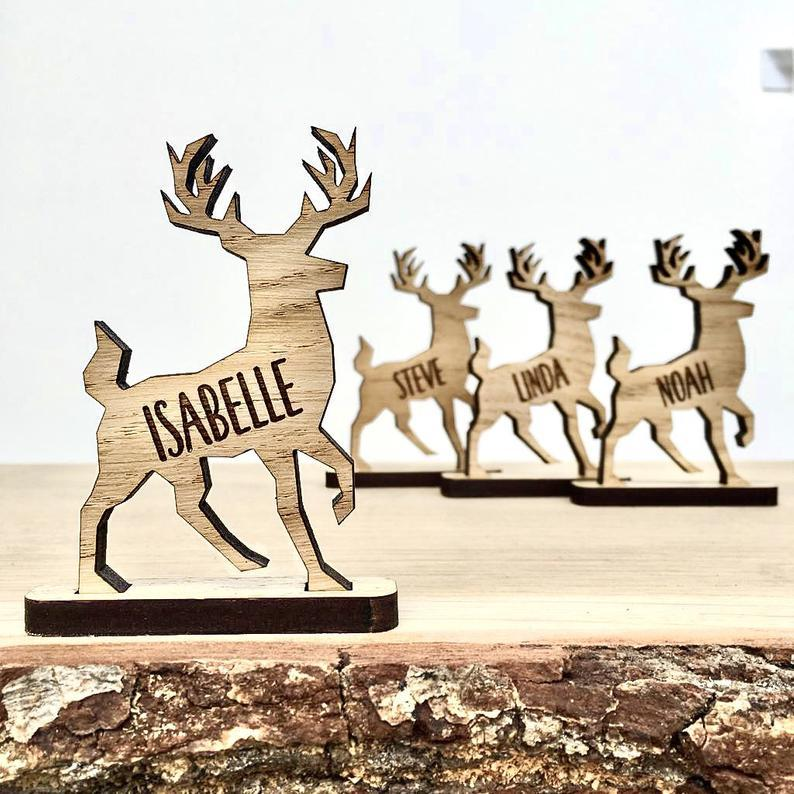 Standing stag or reindeer with engraved name for use on a table as a place name