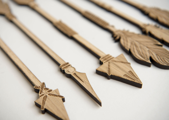 Engraved wood wall art arrows
