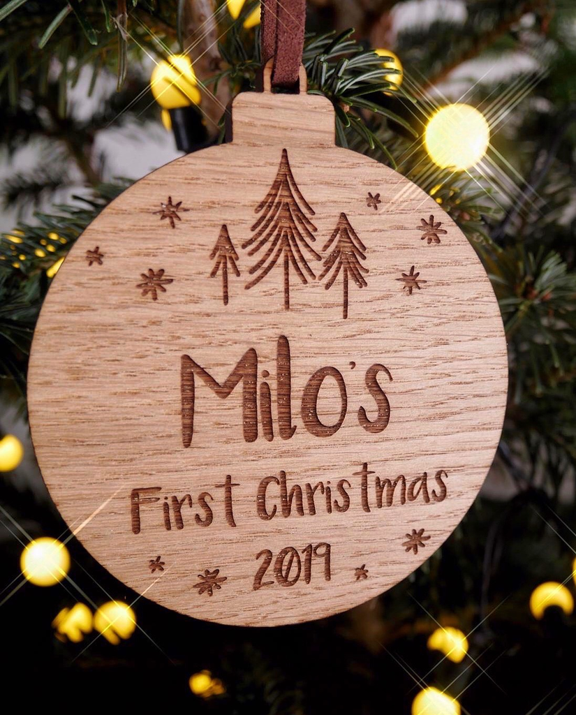 Personalised oak bauble to celebrate baby's first Christmas