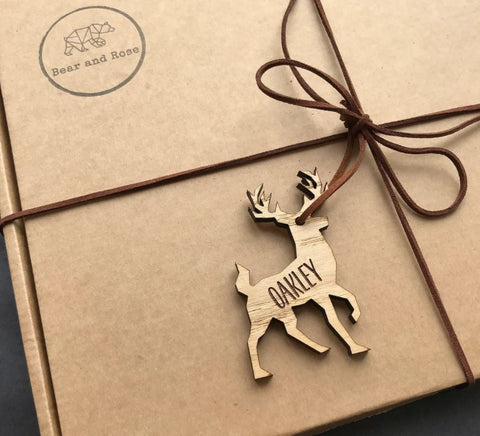 Gift in brown box with Bear and Rose stamp and personalised reindeer gift tag