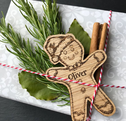 Gift wrapped with personalised wooden gingerbread man tag