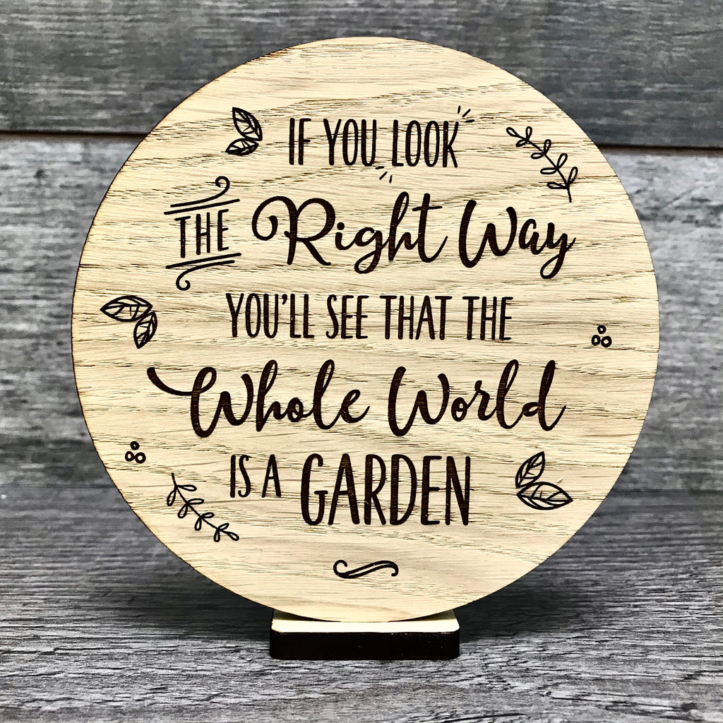 """The whole world is a garden"" wooden disc"