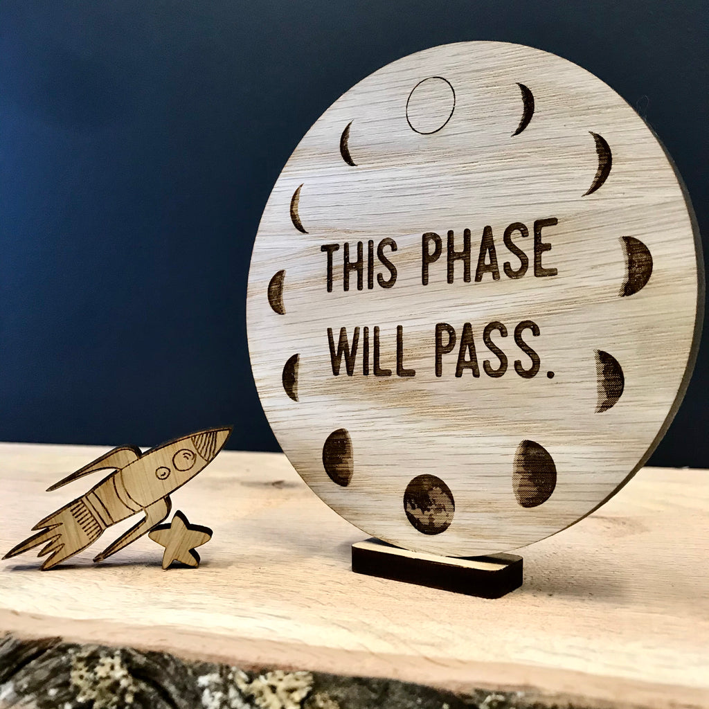 """This phase will pass"" wooden disc"
