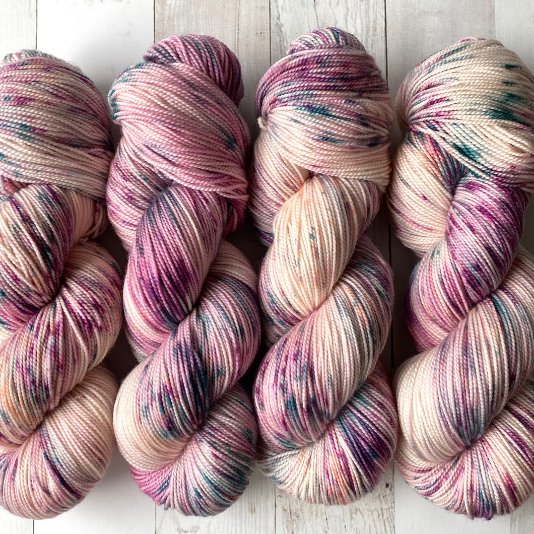 AURORAS AND SAD PROSE | sleek sock | speckled yarn