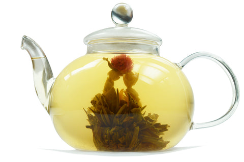 Dragon Flower Tea flowering in a glass teapot