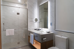 Large frameless bathroom mirror