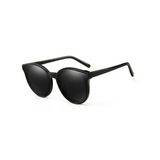 Side view of black, cat eye children's sunglasses, with dark lenses.