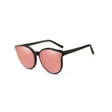 Side view of pink, cat eye children's sunglasses, with mirror lenses.