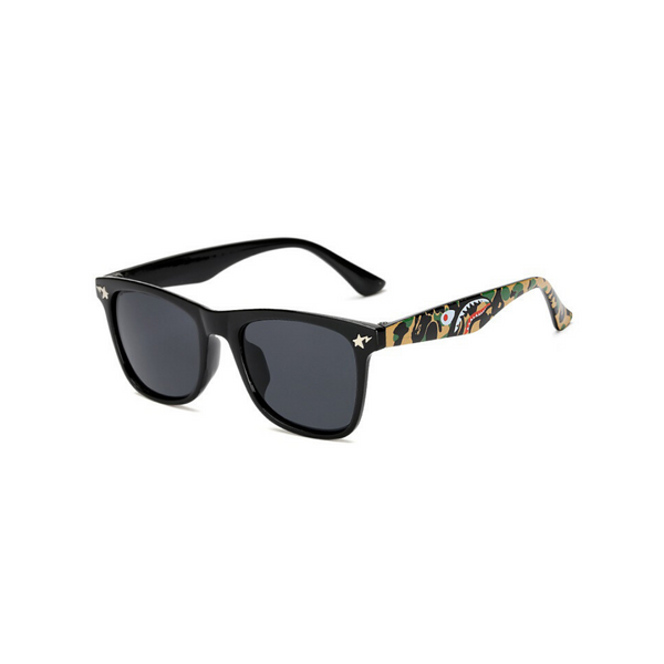 Side view of black, square children's sunglasses, with dark lenses and stars on the lenses.
