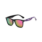 Side view of pink, square children's sunglasses, with mirror lenses and stars on the lenses.