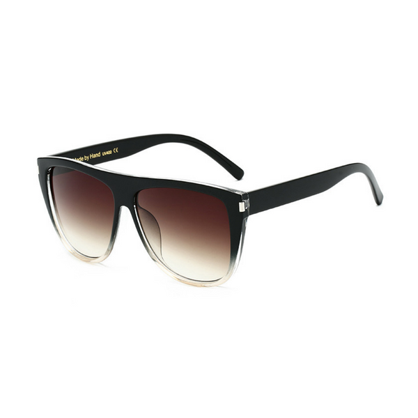 Side view of black and clear, square sunglasses, with black gradient lenses.