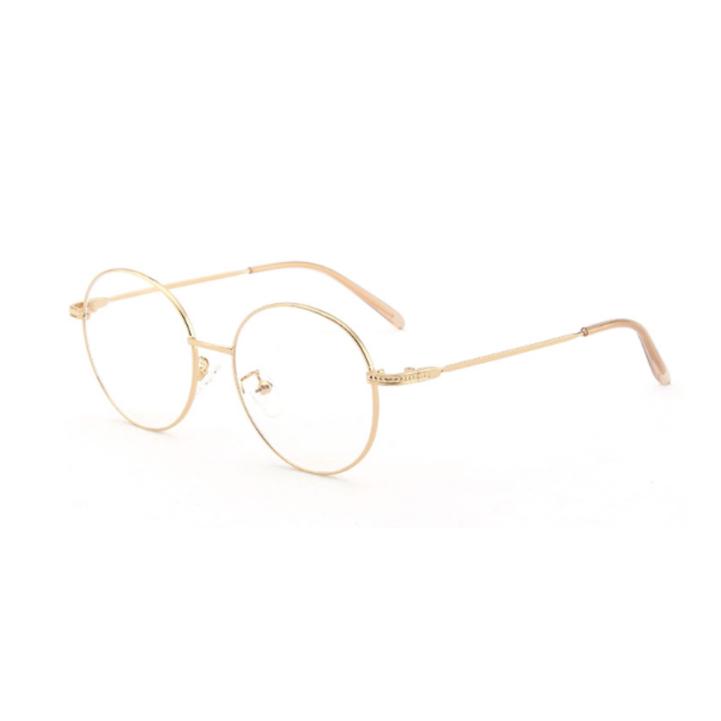 Side view of gold, circle blue light blocking glasses.
