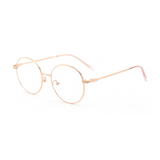 Side view of rose gold, circle blue light blocking glasses.