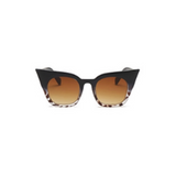Front view of black and leopard, super cat eye children's sunglasses, with brown lenses.