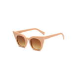 Side view of nude, super cat eye children's sunglasses, with brown lenses.