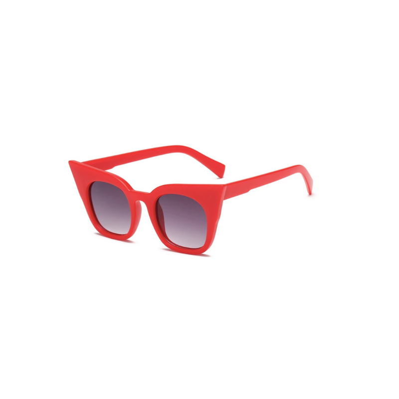 Side view of red, super cat eye children's sunglasses, with black gradient lenses.