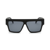 Front view of black, square sunglasses, with dark lenses.