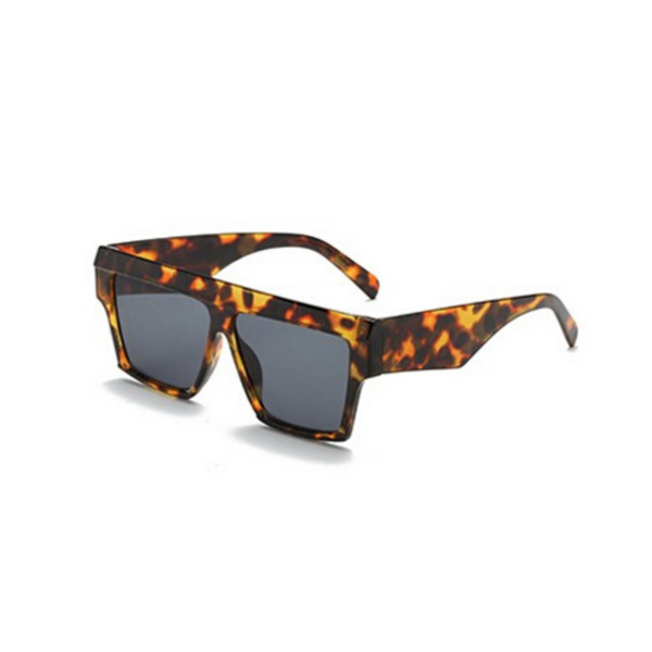 Side view of leopard print, square sunglasses, with dark lenses.