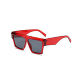Side view of red, flat square sunglasses, with dark lenses.