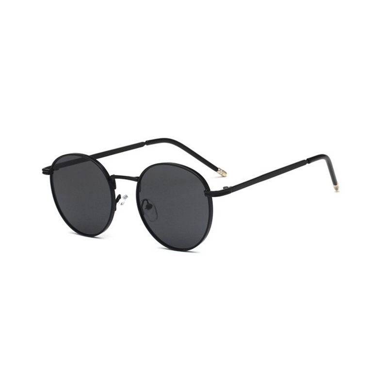 Side view of black, circle sunglasses, with dark lenses.