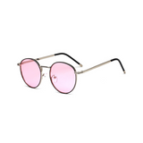 Side view of pink, circle sunglasses, with pink tinted lenses.