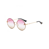 Side view of pink and yellow, large circle sunglasses, with tinted lenses and bee detail on the lenses.